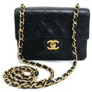 Chanel Timeless / Classic mini bag in black leather