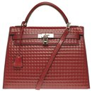 Exceptional and untraceable Hermès Kelly saddle bag handbag 32cm with Barenia Red H leather strap, Palladie silver metal trim