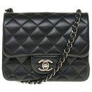 Splendid Chanel Timeless Mini square handbag in black nappa leather, Garniture en métal argenté, almost new !