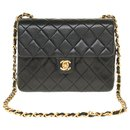 Splendid Chanel Mini Timeless bag in black quilted lambskin, gold plated metal trim