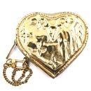 Louis Vuitton Gold Monogram Heart Coin Wallet