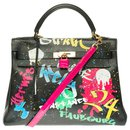 Splendid creation of Hermès Kelly shoulder bag 32 returned in black epsom customized with Pink Croco and the artist PatBo!