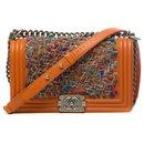 Limited edition - Chanel Boy old medium shoulder bag in orange leather and tweed, Aged silver metal trim