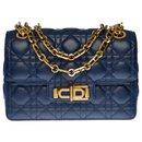 Elegant Christian Dior Miss Dior lined flap shoulder bag in navy blue leather cannage, garniture en métal doré