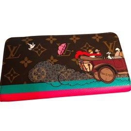 Louis Vuitton-Louis Vuitton portefeuille Zippy collector comme neuf ( évasion).-Autre