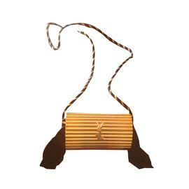 Yves Saint Laurent-Minaudière vintage striée yves saint laurent-Doré