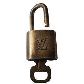 Louis Vuitton-Cadenas  vintage-Doré