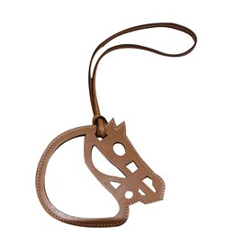 Hermès-Charmm. Tête de cheval Hermès-sable