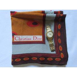 Christian Dior-Montre  ronde CD paqué or. Valeur 1300 EUR-Doré