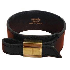 Hermès-Bracelet Hermès en cuir avec cadenas Kelly doré-Noir