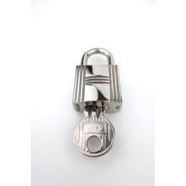 Hermès-Lock number 104 for a Kelly/Birkin-Silvery