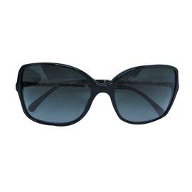 Chanel-Des lunettes de soleil-Noir,Doré