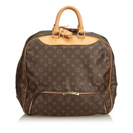 b9fbb177fb30 Louis Vuitton-Évasion monogramme-Marron ...