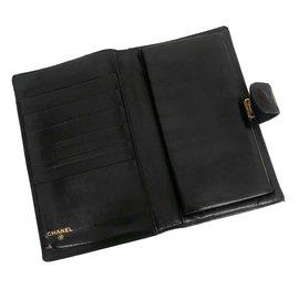 Chanel-Portefeuille Chanel en cuir noir-Noir