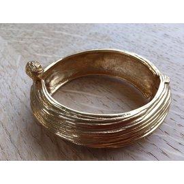 Yves Saint Laurent-Très joli bracelet en métal argenté doré de la maison yve saint Laurent-Doré