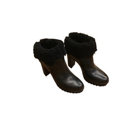 Moncler-Black boots in fur interior-Black