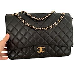 77612af29334 Beautiful Saint Laurent bag in pink leather. Chanel-Chanel Maxi Jumbo black- Black ...