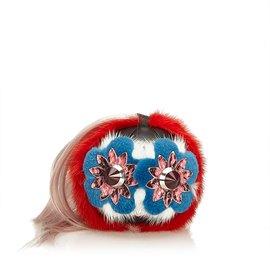 Fendi-Charme sac de pompon en fourrure clouté-Rose,Multicolore