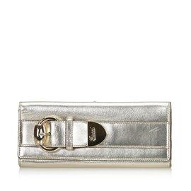 Gucci-Pochette Romy en cuir métallisé-Doré