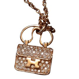 Hermès-amulette constance or rose-Rose
