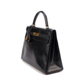 Hermès-Very beautiful Hermes Kelly 3black leather box, golden hardware in very good condition!-Black