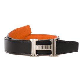 61d97aa271f5 Hermès-Splendide ceinture homme Hermès Reverso en cuir togo orange et en  togo noir avec ...