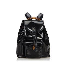 Gucci-Sac à dos à cordon en cuir verni bambou-Noir