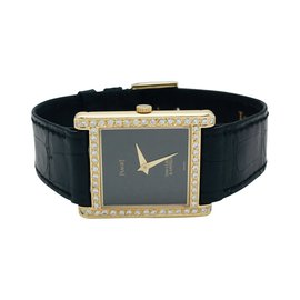 Van Cleef & Arpels-Montre Van Cleef & Arpels et Piaget en or jaune sur cuir, diamants.-Autre
