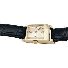 """Hermès-Montre Hermès """"Driver"""" en or jaune, bracelet de cuir.-Autre"""