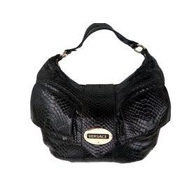 2baf6f00ebf5 Second hand Gianni Versace Luxury bag - Joli Closet
