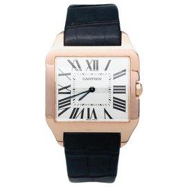 """Cartier-Montre Cartier modèle """"Santos-Dumont"""" en or rose sur cuir.-Autre"""