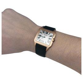 "Cartier-Cartier-Uhr ""Santos-Dumont"" Modell in Rotgold auf Leder.-Andere"