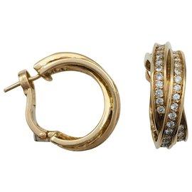 """Cartier-Boucles d'oreilles Cartier """"Trinity"""" en or jaune et diamants.-Autre"""