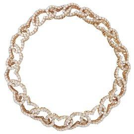 """Chaumet-Collier Chaumet """"Coeurs entrelacés"""" en or jaune et diamants.-Autre"""