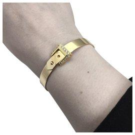 """Hermès-Bracelet Hermès """"Ceinture"""" en or jaune, diamants.-Autre"""