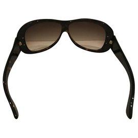 Gucci-Des lunettes de soleil-Marron