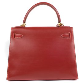 Hermès-Superb Hermes Kelly 28 saddle strap leather box brick red, golden hardware in very good condition!-Red