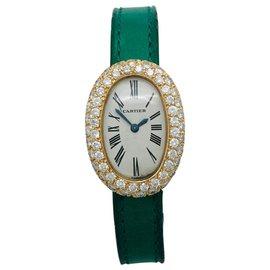 """Cartier-Montre Cartier modèle """"Baignoire"""" en or jaune sur cuir, diamants.-Autre"""