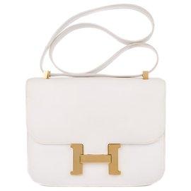 Hermès-Superbe Hermès Constance en cuir de veau grainé blanc, accastillage doré !-Blanc