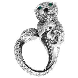 """Cartier-Bague Cartier, modèle """"Féline"""", en platine, diamants, émeraudes et onyx.-Autre"""