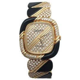 Chaumet-Montre Chaumet, DeLaneau en or jaune, diamants et onyx.-Autre