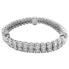 """Cartier-Bracelet lignes Cartier, modèle """"Calypso""""en platine et diamants.-Autre"""