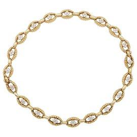 Boucheron-Bracelet Boucheron en or et diamants.-Autre