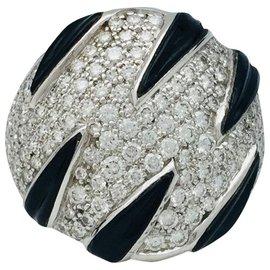 """Cartier-Bague Cartier """"Griffes"""" en or blanc, diamants et onyx.-Autre"""