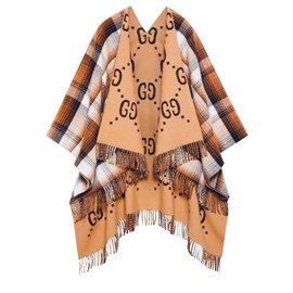 Gucci-Poncho en laine Gucci réversible GG-Beige