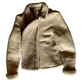 Hermès-Blouson mouton retourné Hermès.-Blanc cassé