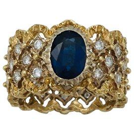 Buccellati-Bague bandeau Buccellati en or jaune, diamants et saphir.-Autre
