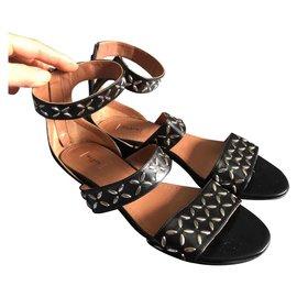Alaïa-Spartan style flat sandals-Black