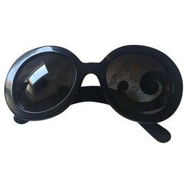 Prada-Des lunettes de soleil-Marron