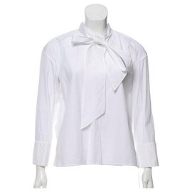 Céline-New with tag Céline white cotton blouse.-White